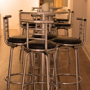 Poseur tables and high back stools can be used indoor or outdoor. Very versatile.